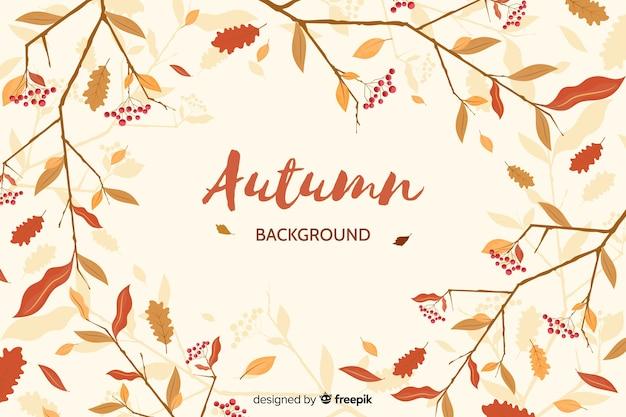 Feuilles dessinées à la main fond automne Vecteur gratuit
