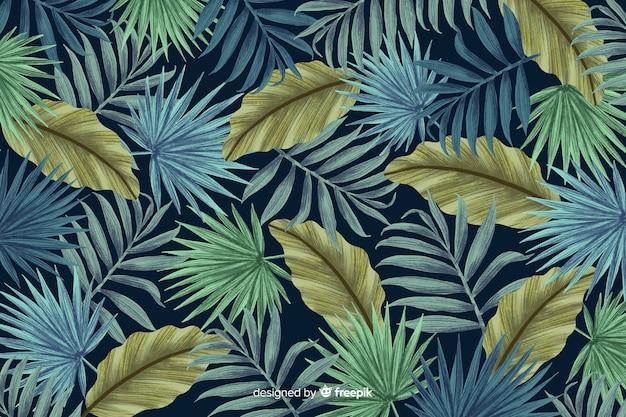 Feuilles tropicales fond style dessiné à la main Vecteur gratuit