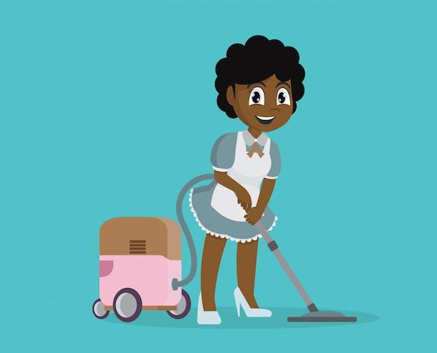 Fille africaine utilisant un aspirateur pour nettoyer la maison. Vecteur Premium
