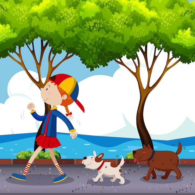 Fille et deux chiens marchant sur la rue Vecteur gratuit