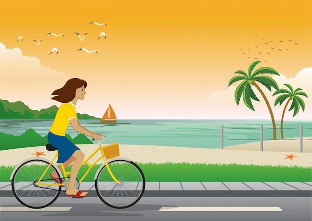 Fille faire du vélo à la plage Vecteur Premium