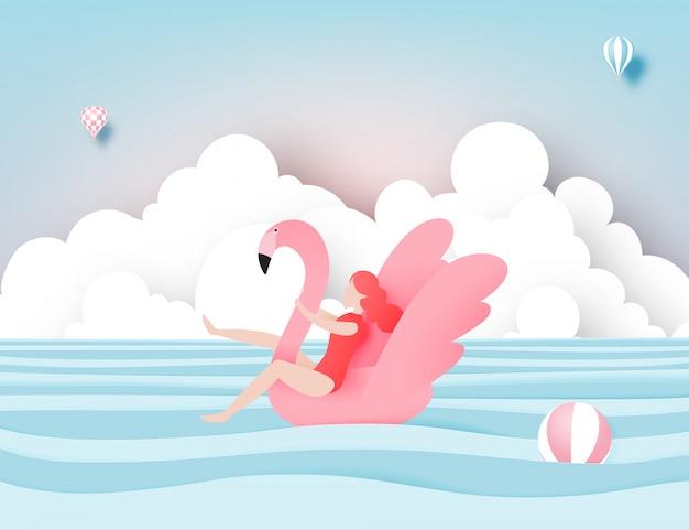 Fille flottant sur la plage avec flamant rose avec du papier de fond de mer magnifique couper style illustration vectorielle Vecteur Premium