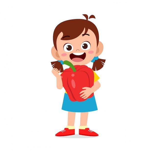 Fille mignonne heureuse enfant tenant des légumes frais Vecteur Premium