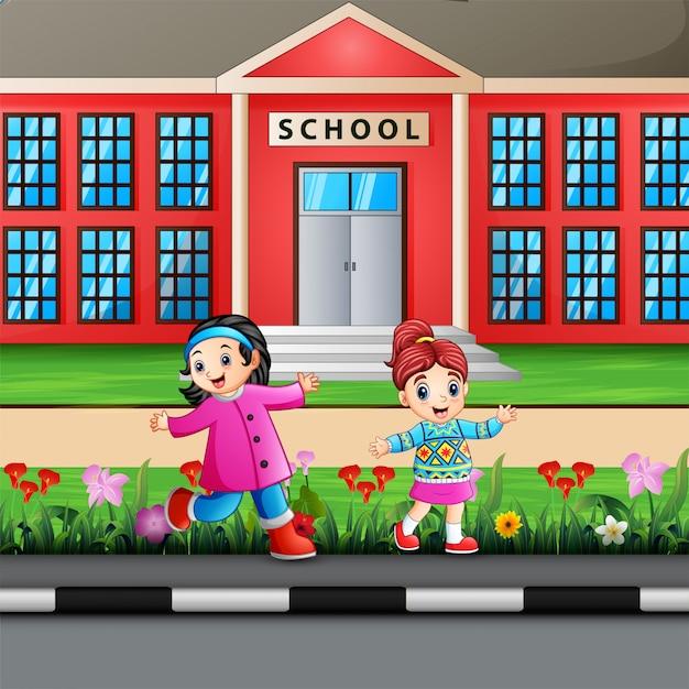 Filles heureux sur la construction de l'école Vecteur Premium