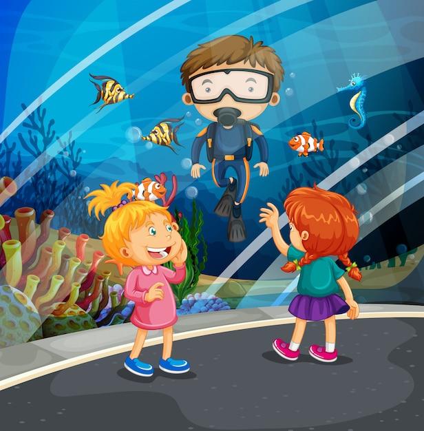 Filles regardant les poissons et plongeur dans l'aquarium Vecteur Premium