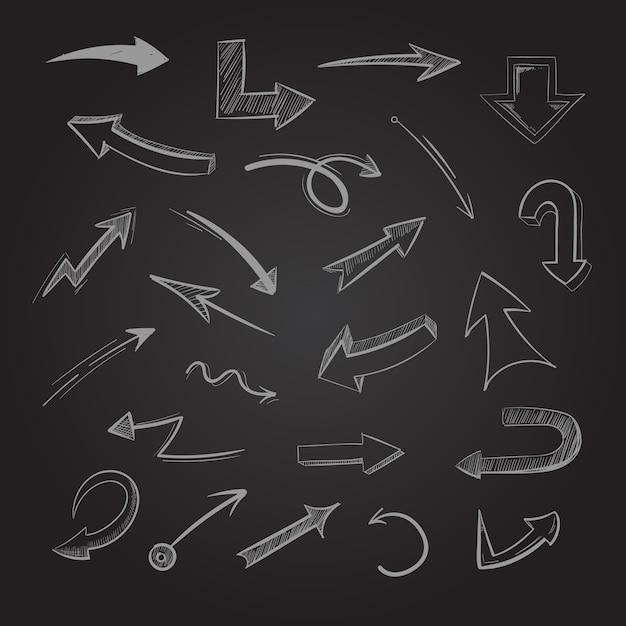 Flèches de craie abstrait doodle sur tableau noir Vecteur Premium