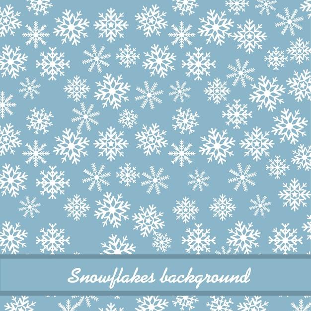 Flocons de neige blancs sur fond bleu. Vecteur Premium