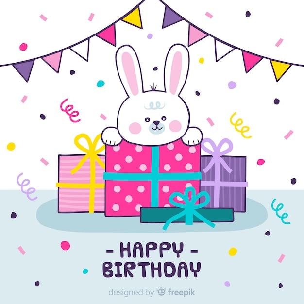 Fond d'anniversaire de lapin dessiné à la main Vecteur gratuit