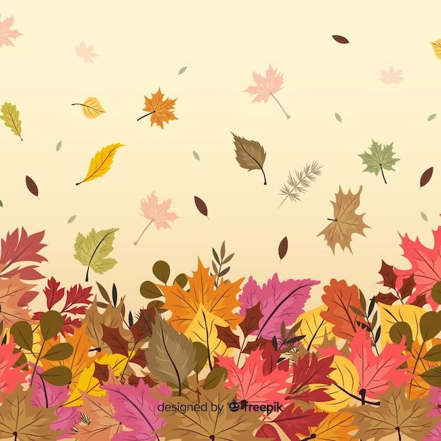 Fond d'automne dessiné avec des feuilles à la main Vecteur gratuit
