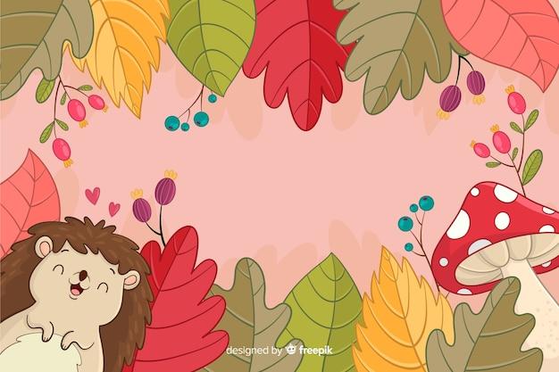Fond d'automne dessiné avec hérisson à la main Vecteur gratuit