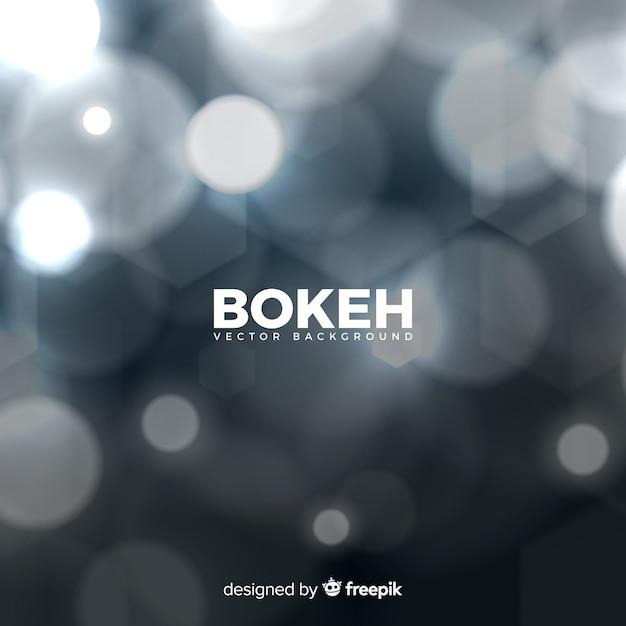 Fond bleu bokeh Vecteur gratuit