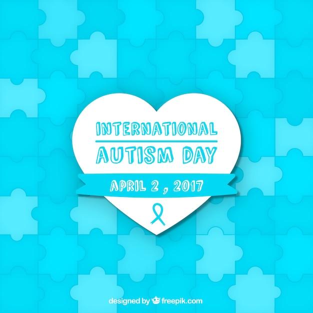 Fond bleu de la journée de l'autisme avec des pièces de puzzle Vecteur gratuit