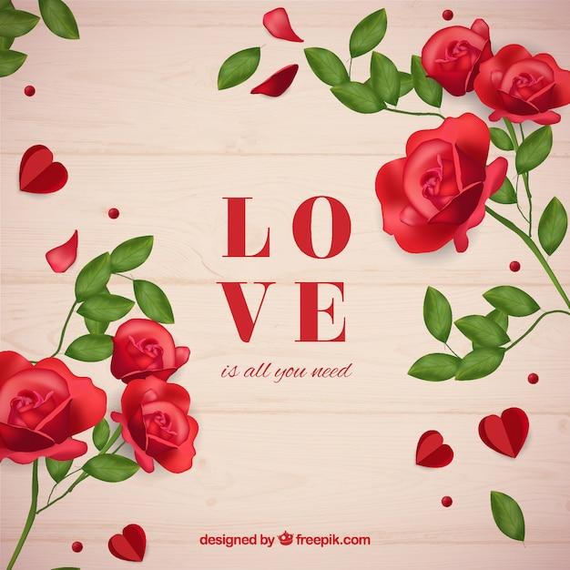 Fond en bois avec mot d'amour et de roses Vecteur gratuit