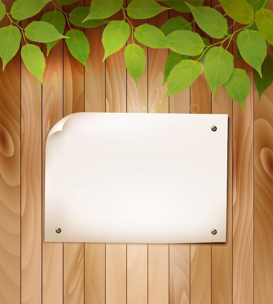 Fond En Bois Naturel Avec Des Feuilles Et Un Morceau De Papier Vierge. Vecteur Premium