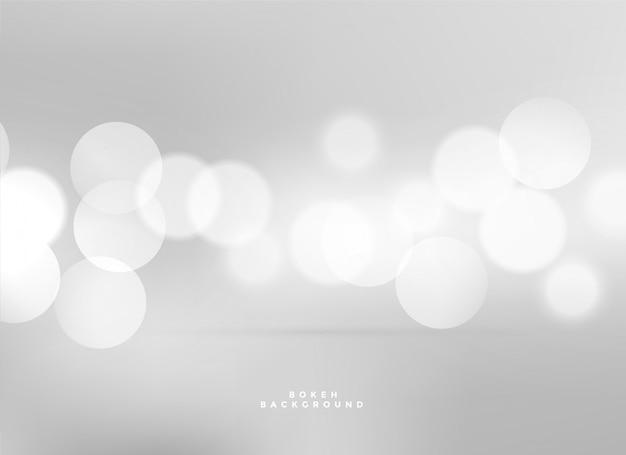 Fond de bokeh de lumières blanches élégantes Vecteur gratuit