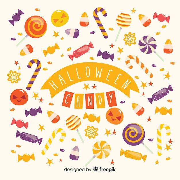 Fond de bonbons colorés d'halloween au design plat Vecteur gratuit