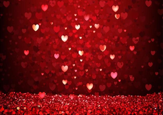 Fond de coeurs rouges scintillants Vecteur Premium