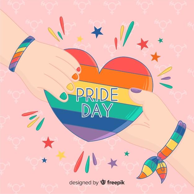 Fond coloré jour de fierté dessiné main Vecteur gratuit