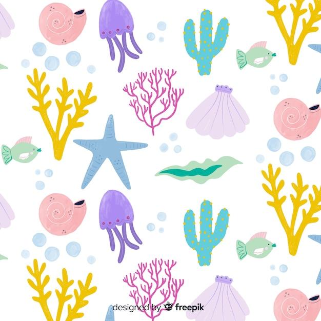 Fond de corail couleur pastel dessiné à la main Vecteur gratuit