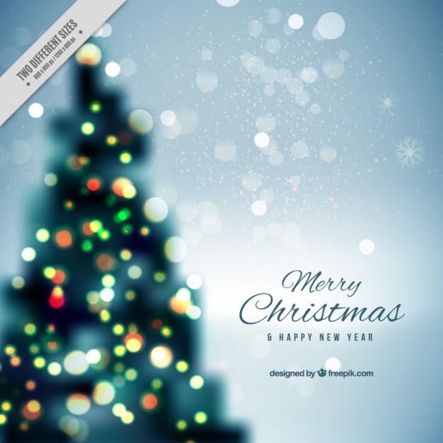 fond Defocused d'arbre de Noël Vecteur gratuit
