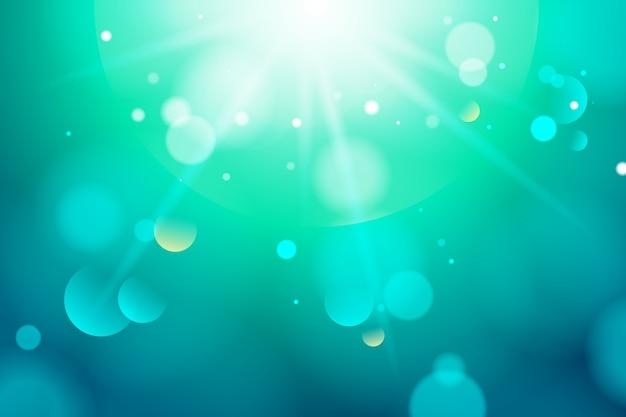 Fond dégradé bleu avec effet bokeh Vecteur gratuit