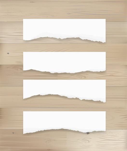 Fond d'étiquette de papier déchiré sur bois. Vecteur Premium