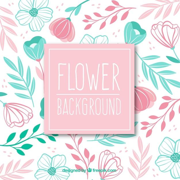 Fond de fleurs dans le style dessiné à la main Vecteur gratuit