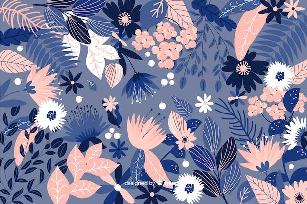 Fond floral bleu dessiné à la main Vecteur gratuit