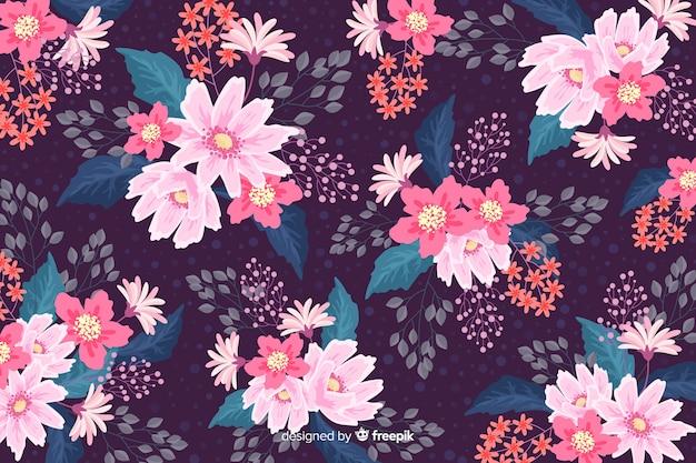 Fond floral coloré au design plat Vecteur gratuit