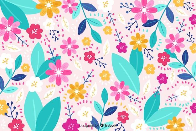 Fond floral coloré dessiné à la main Vecteur gratuit