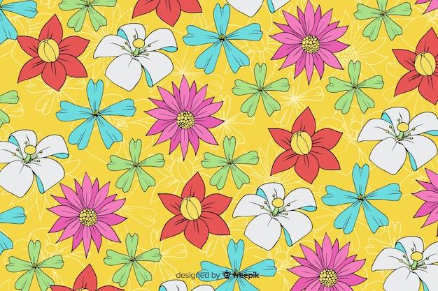 Fond floral dessiné main coloré Vecteur gratuit