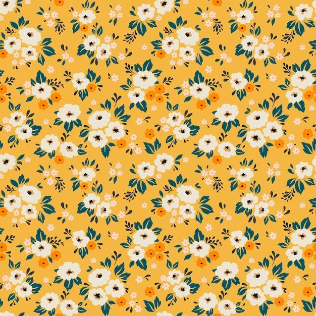 Fond Floral Vintage. Modèle Sans Couture Avec Petites Fleurs Blanches Sur Fond Jaune. Vecteur Premium