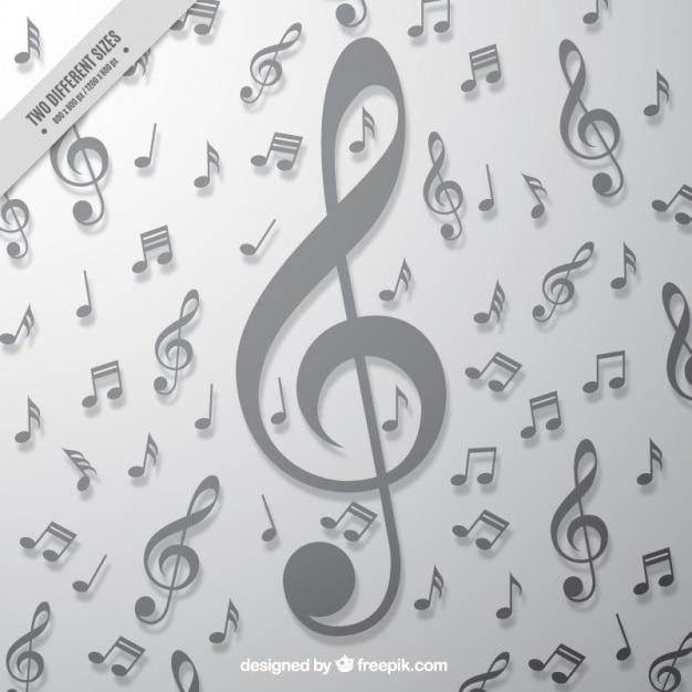Fond gris avec grande clé de sol et de notes de musique Vecteur gratuit