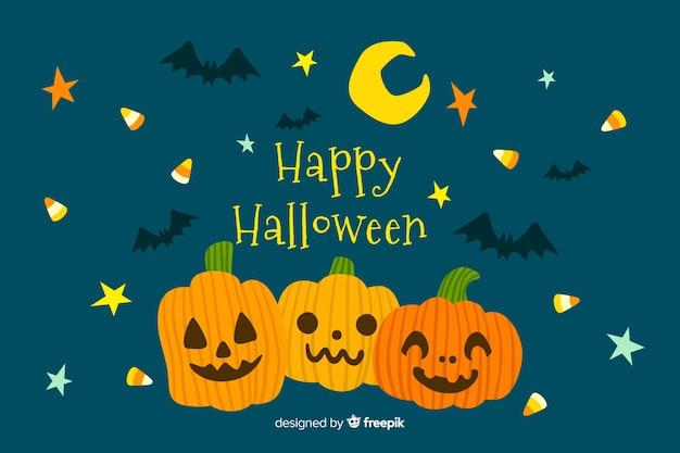 Fond d'halloween dessiné avec des citrouilles à la main Vecteur gratuit