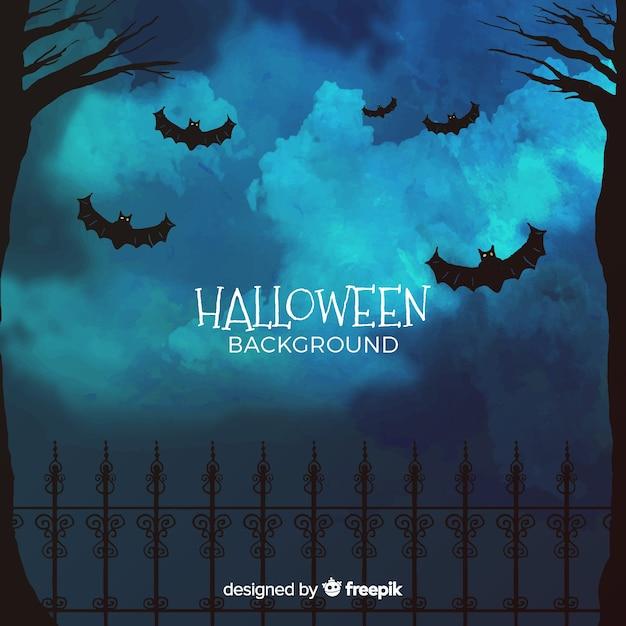 Fond d'halloween avec forêt et chauves-souris Vecteur gratuit