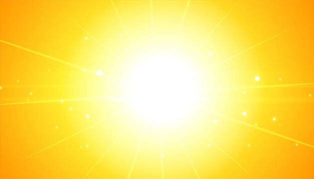 Fond Jaune Avec Des Rayons Lumineux Flare Vecteur gratuit