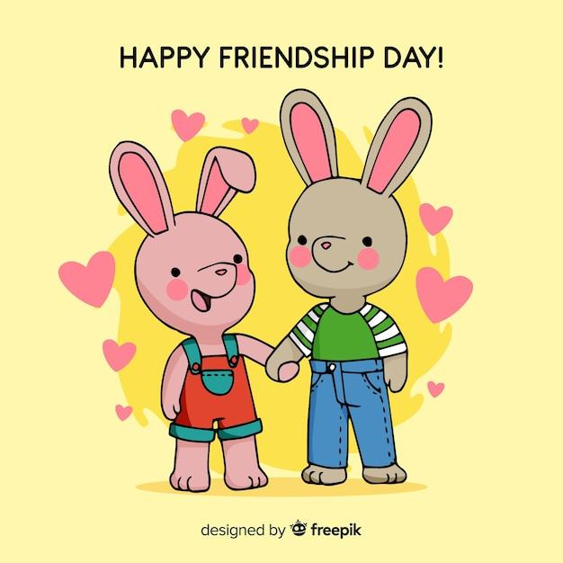 Fond de jour de l'amitié lapins dessinés à la main Vecteur gratuit