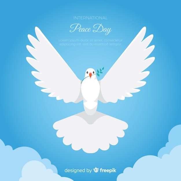 Fond de jour de paix avec la colombe blanche Vecteur gratuit
