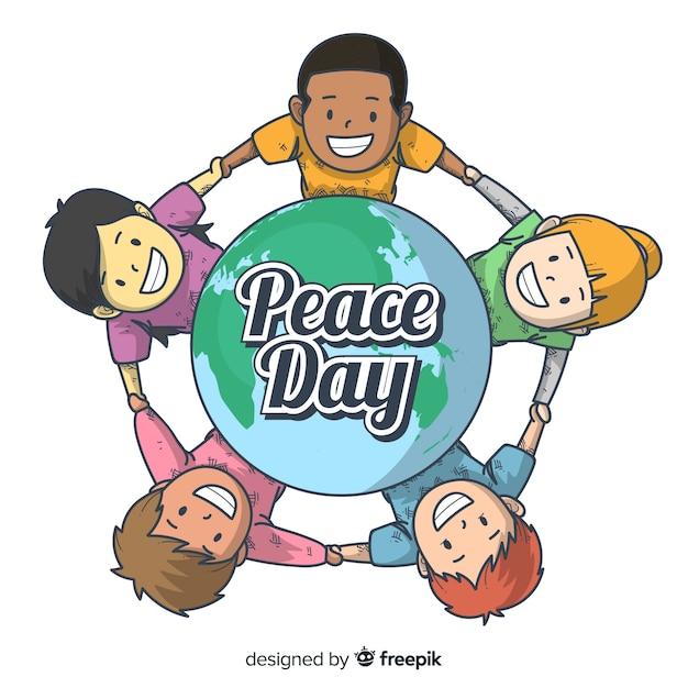 Fond de jour de paix avec des enfants tenant les mains autour de la terre Vecteur gratuit