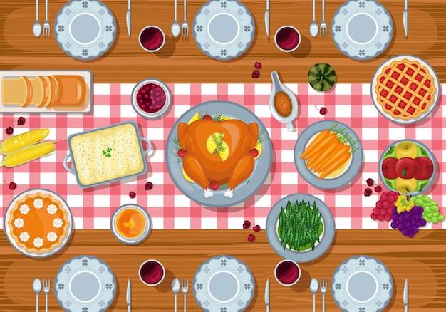 Fond de jour de thanksgiving avec dîner de fête traditionnelle sur une table en bois Vecteur Premium