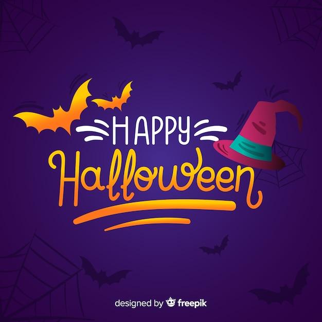 Fond de lettrage halloween heureux Vecteur gratuit