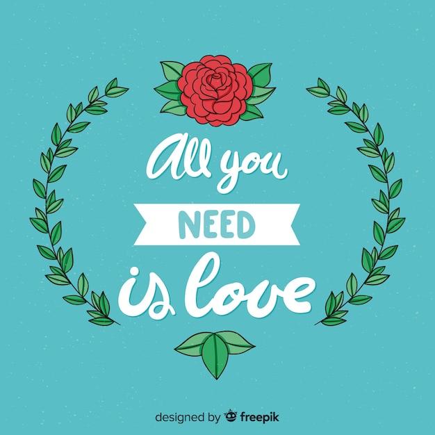 Fond de message de lettrage romantique avec des fleurs Vecteur gratuit