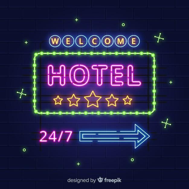 Fond de néon réaliste hôtel Vecteur gratuit