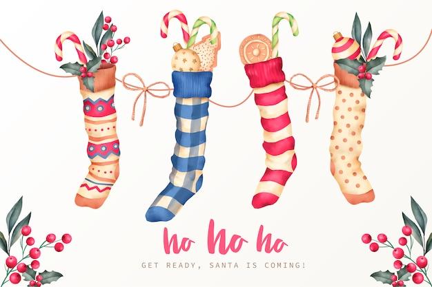 Fond de noël avec des chaussettes d'hiver et des bonbons Vecteur gratuit