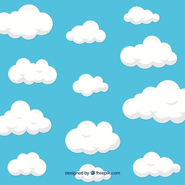 Fond de nuages dans un design plat Vecteur gratuit