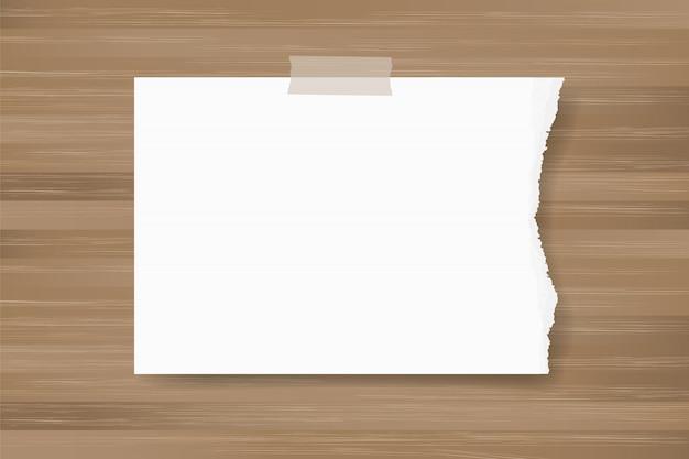 Fond de papier déchiré coller sur la texture du bois. Vecteur Premium