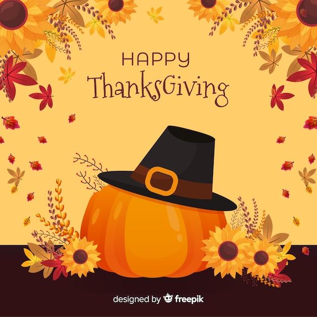 Fond plat de thanksgiving avec citrouille et chapeau Vecteur gratuit