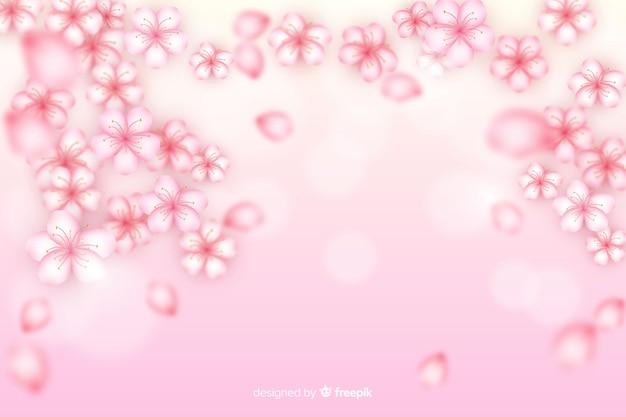 Fond réaliste de fleurs de cerisier Vecteur gratuit