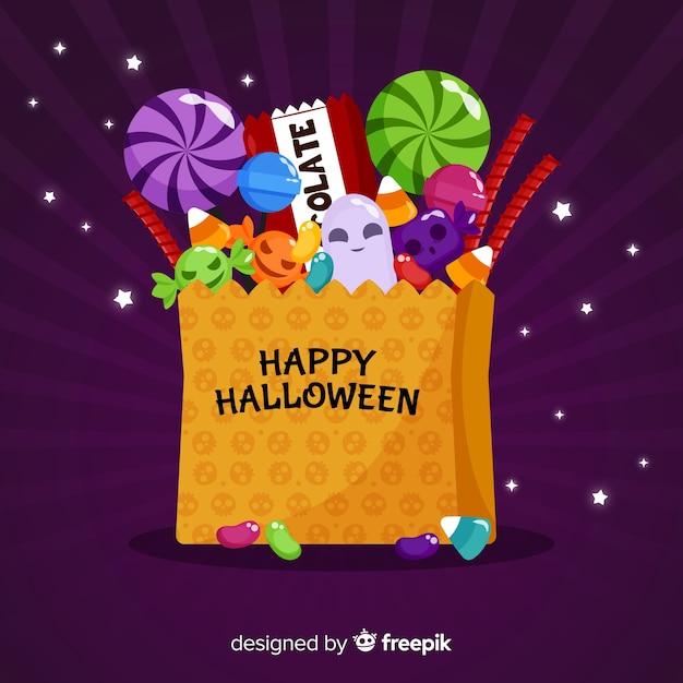Fond de sac de bonbons halloween moderne Vecteur gratuit