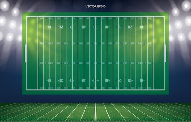 Fond de stade de terrain de football avec motif de ligne de perspective du champ d'herbe verte. Vecteur Premium